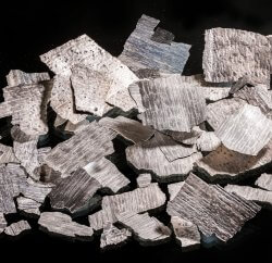 Less Common Metals Neodymium flake used in the manufacture of permanent magnets
